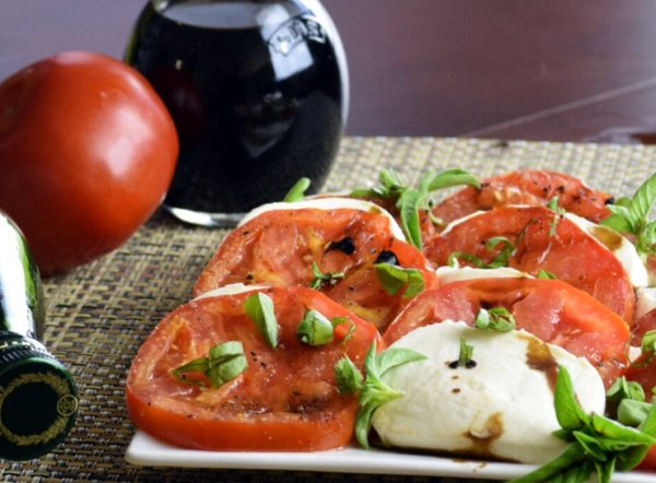 Grilled Tomato Caprese Salad lightly drizzled with olive oil and balsamic vinegar.