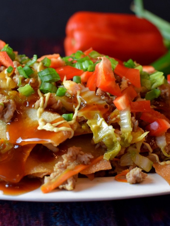egg roll nachos close up on white plate