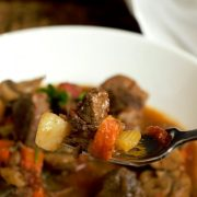 Celery, Carrots, Potato, Tomato, and tender Beef all on the fork to make a perfect bite of Instant Pot Stew.