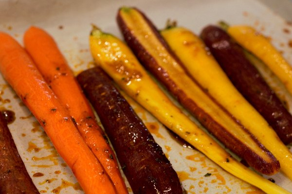 Carrots have been roasting for 20 minutes and are ready to turn.