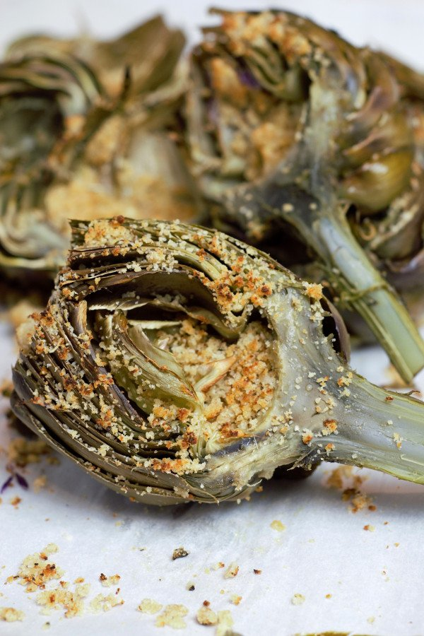 Perfectly cooked Parmesan Stuffed Artichokes ready to devour.