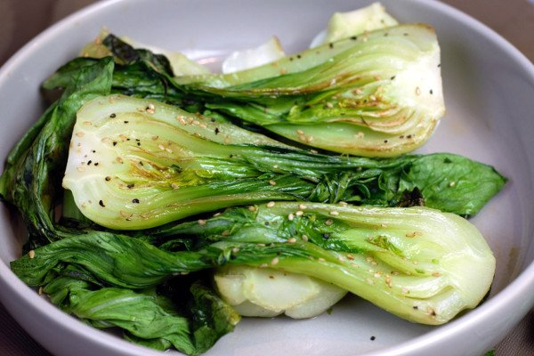 Sesame Grilled Baby Bok Choy drizzled with sesame oil and topped with sesame seeds.