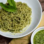bowl of pasta with pesto in white bowl