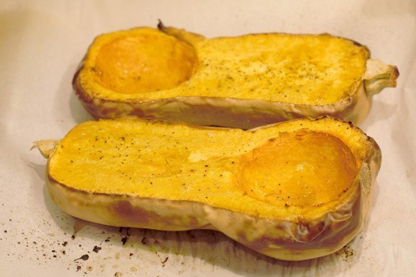Roasted Butternut Squash halves with nutmeg, salt, pepper, and chili powder.