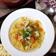 close up of chicken noodle soup with spoon