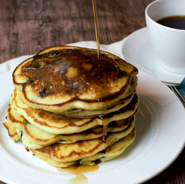 Stack of pancakes with coffee