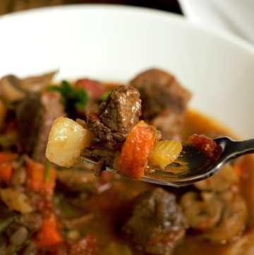 fork full of beef stew
