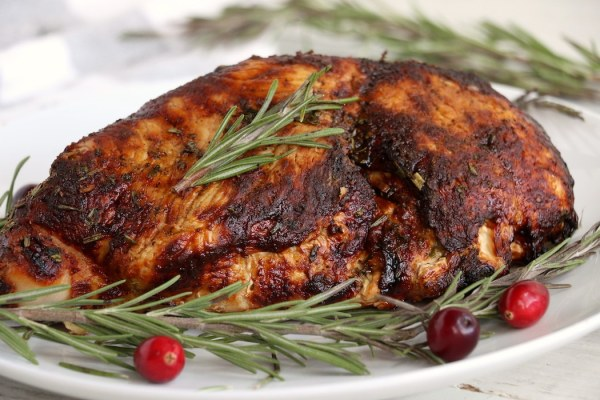 turkey breast on platter with greens