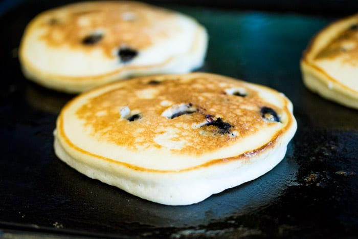 Blueberry Pancakes Recipe Cooking on a Griddle