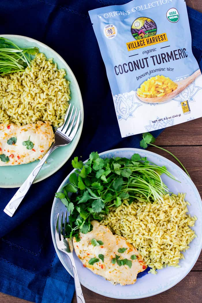 2 Plates of Chicken and Rice with a Package of Village Harvest Coconut Turmeric Rice as the Instant Pot Side Dish Solution