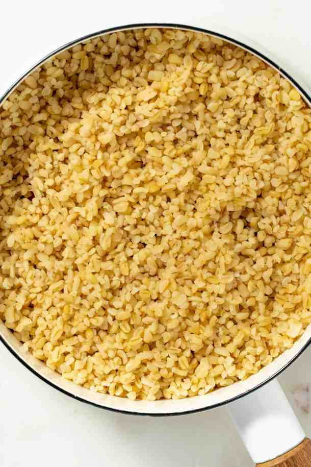 close up picture of cooked bulgur in a white pot