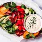 Tahini sauce with a platter of fresh vegetables