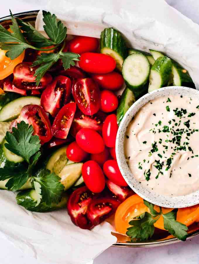lebanese Tahini sauce with a platter of fresh vegetables