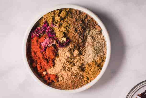 small white bowl of baharat spice blend