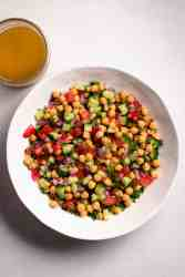 A white bowl chickpea salad