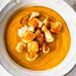 A bowl of roasted butternut squash soup topped with halloumi