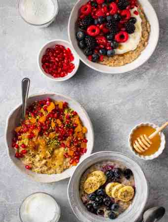 Three bowls of Oatmeal with various toppings