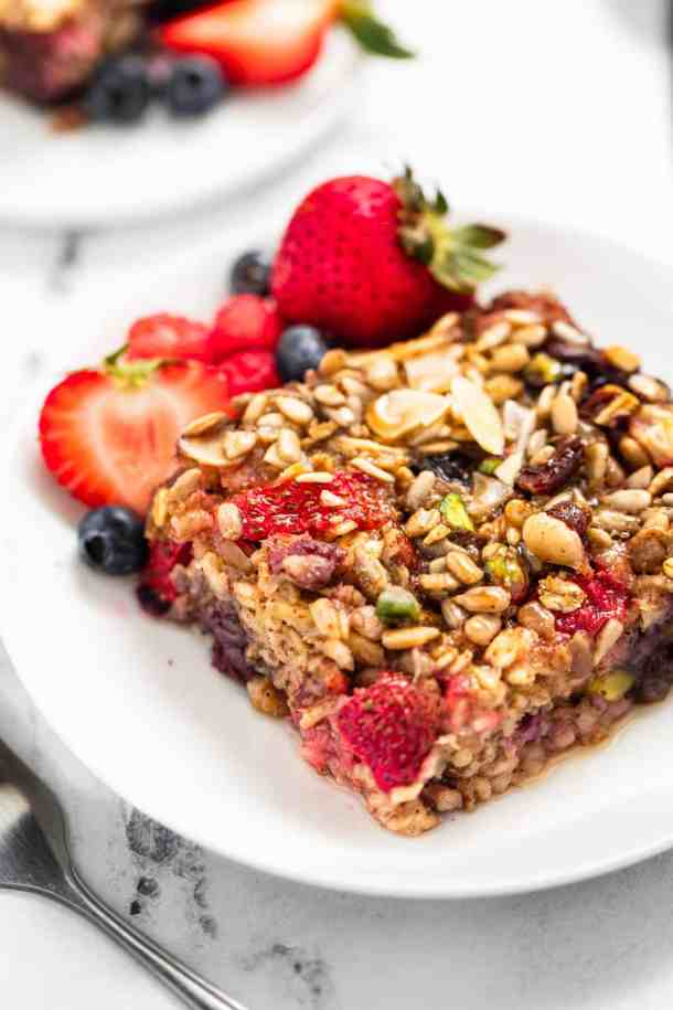Two white plates with berry baked oatmeal