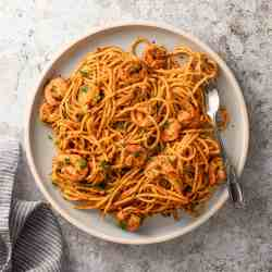 moroccan shrimp pasta on a plate with fork