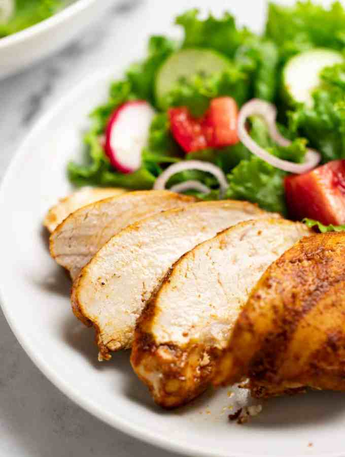 Oven baked Shawarma chicken breast on a plate with salad