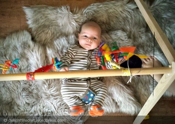 baby playing homemade baby gym