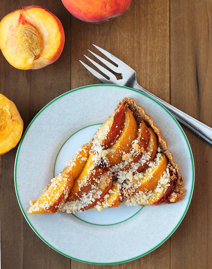 This light and not too sweet, vegan gluten free baked peach tart is the perfect summer dessert to make and share with friends and family.