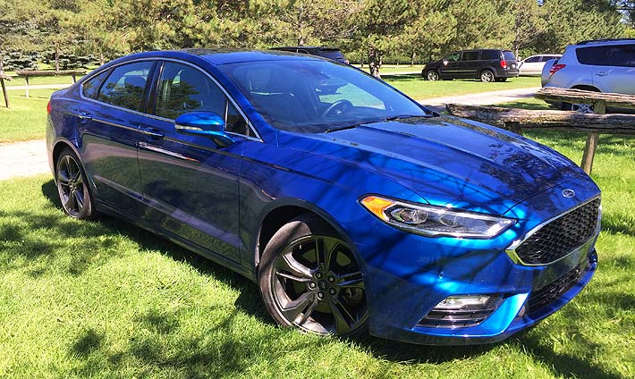 Side shot of a blue Ford Fusion Sport