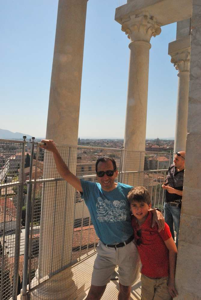 Climbing on top of Pisa leaning tower with child