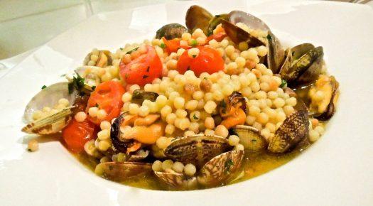 Italian pasta dishes - Fregola ai frutti di mare