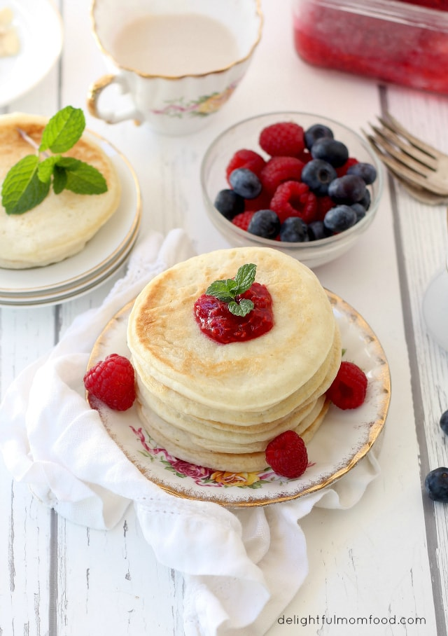 stacked buttermilk pancakes with sauce