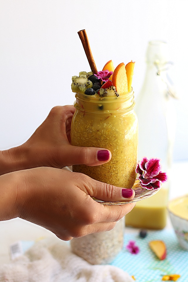 Easy overnight oats in golden milk tea. topped in fresh fruit. Vegan and healthy!
