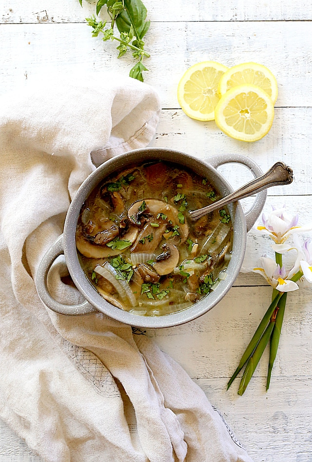 Healthy mushroom soup with bay leaves, white wine and broth