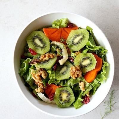 Winter Salad With Kiwifruit, Fuyu Persimmon, Walnuts and Cranberry