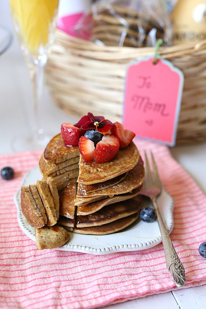 Warm and delicious banana oat pancakes smothered in thick maple syrup and made in a blender. A quick and healthy flourless pancake recipe with heart-healthy ingredients.