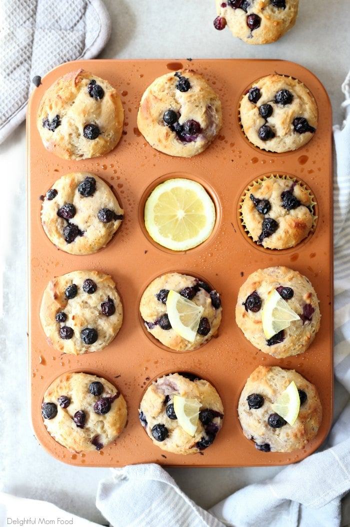 Light and healthy lemon blueberry yogurt muffins packed with Greek yogurt protein and whole food gluten-free ingredients! #glutenfree #muffins #blueberry #lemon #Greekyogurt #yogurt #healthy #easy #breakfast #snack | Recipe at delightfulmomfood.com