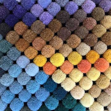 delinear's poms show more than one hundred possible colors for your custom rug. Color matching is also available.