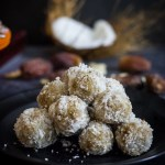 coconut date balls in black plate