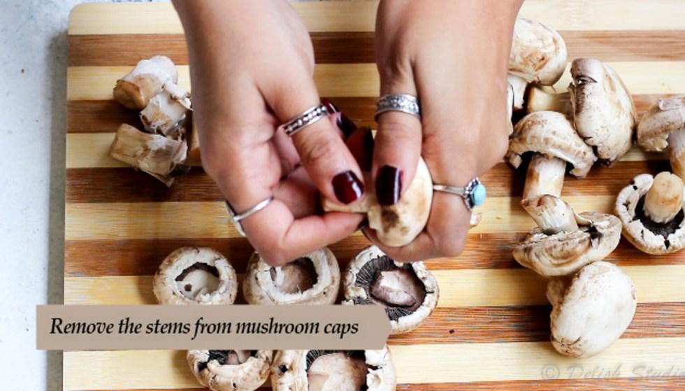 Remove stem from mushroom caps for making cheese stuffed mushrooms