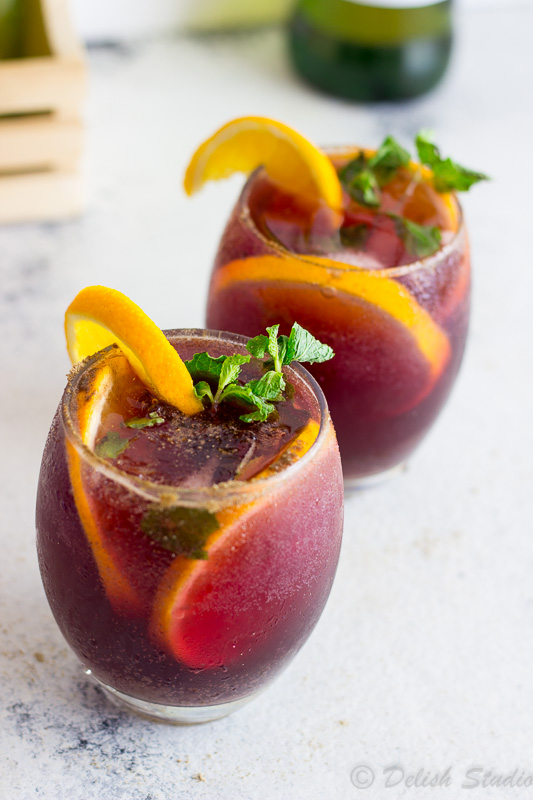 Orange wedges on top of Jaljeera mixed with the goodness of Red wine Sangria is what makes up this tangy, boozy, fizzy refreshing summer cocktail! Super easy to make this is recipe gives an Indian twist to classic Red wine Sangria!