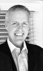 Black and white photo of John Christian, Delivery Limited CEO