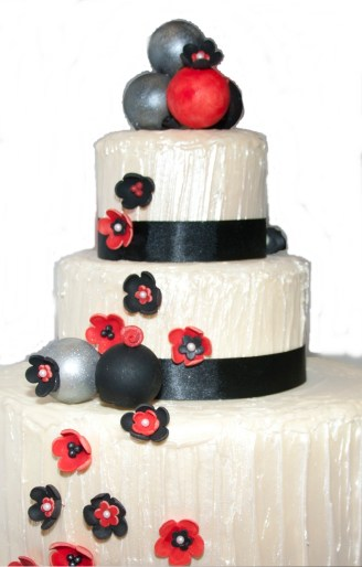 white-chocolate-wedding-cake-with-red-silver-black-cake-pops-crop2
