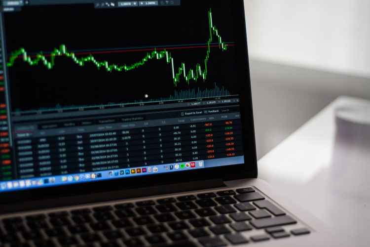 black laptop computer showing stock graph - 8 Advantages of Trading Forex That Will Motivate You to Get Started