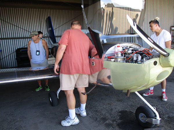 Delta students examine airplane's engine and internal functions at the Stockton Airport.