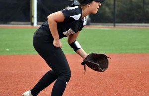 Tawny Deerink goes low for a softball at Delta College on March 3 in Stockton. PHOTO BY EMILY CORDER