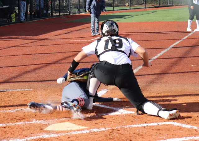 Janelle Rodriguez tags a runner out at home in the third inning. Photo by Paul Muyskens