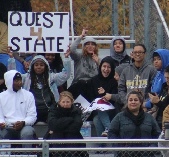 Women's basketball cheering on the women's soccer team from earlier this season during their state championship run.