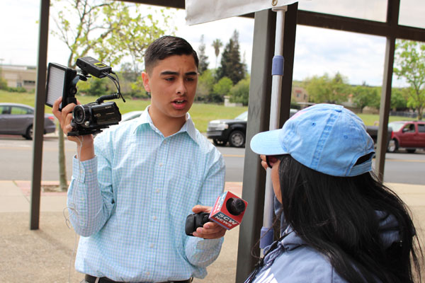 High school journalist Gabe Porras interviews protester at the Stockton Slut Walk on his channel SCW News. Photos by Ayaana Williams