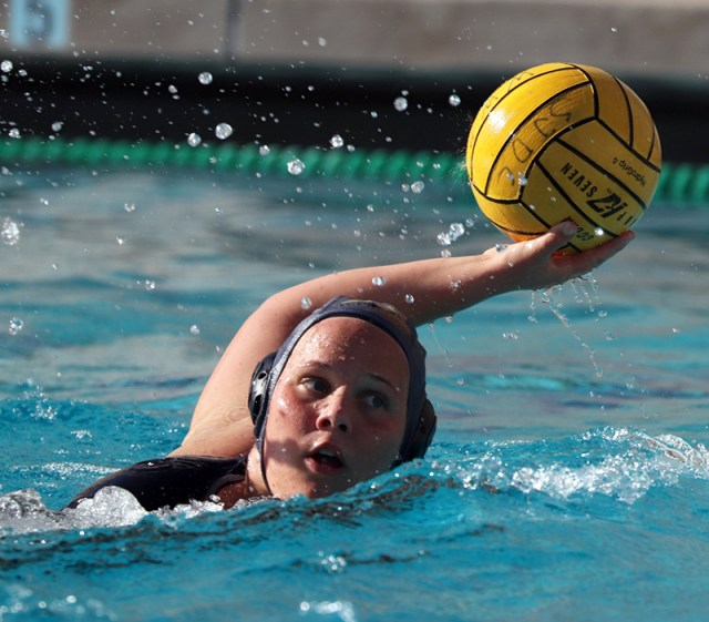 Whitney Lee looks to pass the ball to a teammate. Photo by Paul Muyskens.