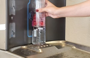 Mikayla Franco fills a water bottle at one of the new hydration stations in Danner Hall. Photo by Madelynn Thomas