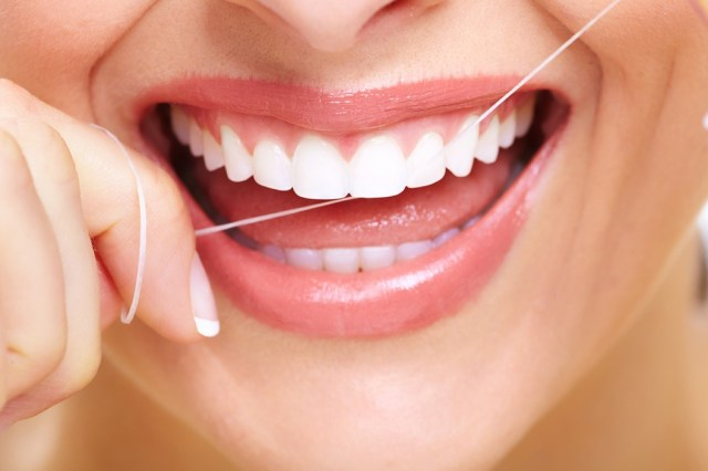 Image result for flossing teeth